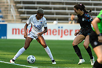 BRIDGEVIEW, IL - JULY 18: Tziarra King #23 of the OL Reign plays the ball during a game between OL Reign and Chicago Red Stars at SeatGeek Stadium on July 18, 2021 in Bridgeview, Illinois.