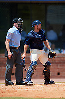 Mobile BayBears catcher Wade Wass (10) and home plate umpire Matt Winter during a game against the Pensacola Blue Wahoos on April 26, 2017 at Hank Aaron Stadium in Mobile, Alabama.  Pensacola defeated Mobile 5-3.  (Mike Janes/Four Seam Images)