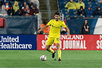FOXBOROUGH, MA - AUGUST 4: Eric Miller #15 of Nashville SC dribbles during a game between Nashville SC and New England Revolution at Gillette Stadium on August 4, 2021 in Foxborough, Massachusetts.
