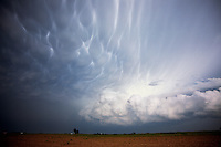 A curious combination of cloud textures adorns the backside of this supercell thunderstorm in southern Nebraska on May 22nd, 2004. The upper bulbous-type clouds are known as mammatus while the lower cauliflower-type clouds are cumulus congestus and cumulonimbus.