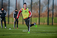 SWANSEA, WALES - JANUARY 28: Matt Grimes hunts for the ball during training  on January 28, 2015 in Swansea, Wales.