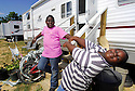 Ten-year-old Yajaira Blanks and her brother Keree Blanks, seven years old, hang out at their FEMA trailer during a school day at Renaissance Village in Baker, Louisiana, May 19, 2006.<br />(Cheryl Gerber for New York Times)