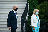 U.S. President Joe Biden walks with U.S. First Lady Jill Biden on the South Lawn of the White House before boarding Marine One in Washington, D.C., U.S., on Friday, September 24, 2021. Biden and the leaders of Australia, India, and Japan made a show of unity against China today, meeting together at the White House in a first-ever summit to discuss initiatives to counter Beijing's influence across the Pacific. Photographer: Al Drago/Bloomberg<br /> Credit: Al Drago / Pool via CNP /MediaPunch