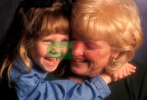 granddaughter hugging and laughing with her grandmother