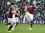 Callum Paterson hooks the ball and catches Nicky Law