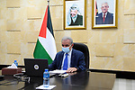 Palestinian Prime Minister Mohammad Ishtayeh, speaks during his speech at the thirteenth meeting of the Board of Trustees of the Yasser Arafat Foundation, via a video link in the West Bank city of Ramallah, on February 28, 2021. Photo by Prime Minister Office