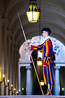 Pontifical (Papal) Swiss Guard with his blue, red, orange, and yellow Renaissance uniform in service in the Vatican, Rome Italy, Southern Europe