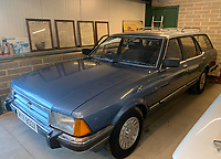 BNPS.co.uk (01202 558833)<br /> Pic: Mathewsons/BNPS<br /> <br /> Royal estate going cheap...<br /> <br /> A humble Ford Granada car that belonged to the Queen Mother has emerged for sale for £5,000.<br /> <br /> The everyday estate car was leased by the Royal fleet in 1983 having been made by Ford a year earlier.<br /> <br /> It is unclear what regal duties it was used to fulfill but it was driven regularly by the Queen Mum, covering 19,000 miles in Royal service.