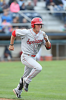 Dylan Moore (19) of the Spokane Indians runs to first base during a game against the Everett AquaSox at Everett Memorial Stadium on July 25, 2015 in Everett, Washington. Spokane defeated Everett, 10-1. (Larry Goren/Four Seam Images)