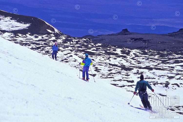 Skiers on Mauna Kea volcano on the Big Island of Hawaii. Highest mountain in the state of Hawaii