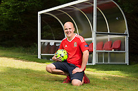 """COPY BY TOM BEDFORD<br />Pictured: Matt Evans in his back garden at his house in south Wales, UK<br />Re: A soccer-mad lottery millionaire has splashed out on his own football pitch complete with a dug-out on the touchline.<br />Former postman Matt Evans 37, turned his back garden into a mini soccer stadium so his mates can come for a kick about.<br />The super-rich bachelor is blowing his fortune on his love for the beautiful game.<br />He said: """"I'm living the dream by having my own pitch with lifesize goals and all the white markings.<br />""""I invite my old workmates around for a game and we sit in the dugout to talk about football.<br />""""My dad comes along for a game but we usually ask him to play in goal.""""<br />Matt was a £300-a-week postman three years ago using jumpers for goalposts in his local park.<br />But after a lottery lucky dip netted him £2,604,015 he's living the life of a Premiership soccer star."""