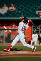 Lansing Lugnuts Griffin Conine (38) hits a two run home run during a Midwest League game against the Burlington Bees on July 18, 2019 at Cooley Law School Stadium in Lansing, Michigan.  Lansing defeated Burlington 5-4.  (Mike Janes/Four Seam Images)