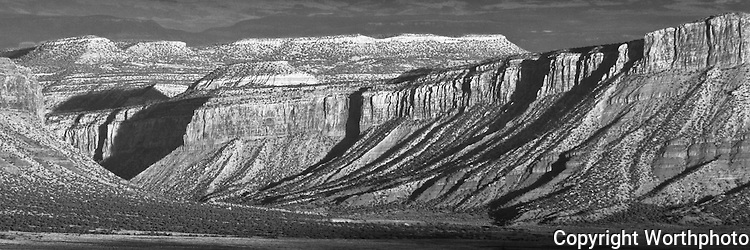 Sunset casts shadows across the cliffs of Paradox Valley, Colorado.