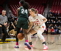 COLLEGE PARK, MD - FEBRUARY 03: Faith Masonius #13 of Maryland pokes the ball through the legs of Nia Clouden #24 of Michigan State during a game between Michigan State and Maryland at Xfinity Center on February 03, 2020 in College Park, Maryland.