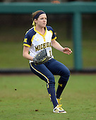 Michigan Wolverines outfielder Lyndsay Doyle (11) backs up a play during the season opener against the Florida Gators on February 8, 2014 at the USF Softball Stadium in Tampa, Florida.  Florida defeated Michigan 9-4 in extra innings.  (Copyright Mike Janes Photography)