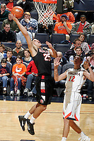 Dec. 22, 2010; Charlottesville, VA, USA; Seattle Redhawks forward Brandon Durham (25) shoots the ball in front of Virginia Cavaliers guard Joe Harris (12) during the game at the John Paul Jones Arena. Seattle Redhawks won 59-53. Mandatory Credit: Andrew Shurtleff