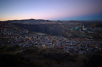 The open-pit mine run by Volcan is seen early in the morning in the center of the city of Cerro de Pasco, Peru.