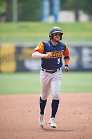 Vimael Machín (9) of the Las Vegas Aviators trots around the bases against the Salt Lake Bees at Smith's Ballpark on July 25, 2021 in Salt Lake City, Utah. The Aviators defeated the Bees 10-6. (Stephen Smith/Four Seam Images)