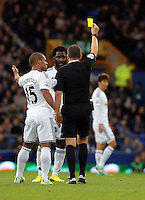 Liverpool, UK. Saturday 01 November 2014<br /> Pictured L-R: Wayne Routledge of Swansea is protesting with team mate Wilfried Bony to referee Kevin Friend for showing a yellow card to Bony. <br /> Re: Premier League Everton v Swansea City FC at Goodison Park, Liverpool, Merseyside, UK.