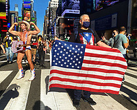 November 7, 2020. Joe Biden and Kamala Harris announce their election win and New York Ciy celebrates. Crowds gather in Times Square. The Naked Cowboy strikes a pose.