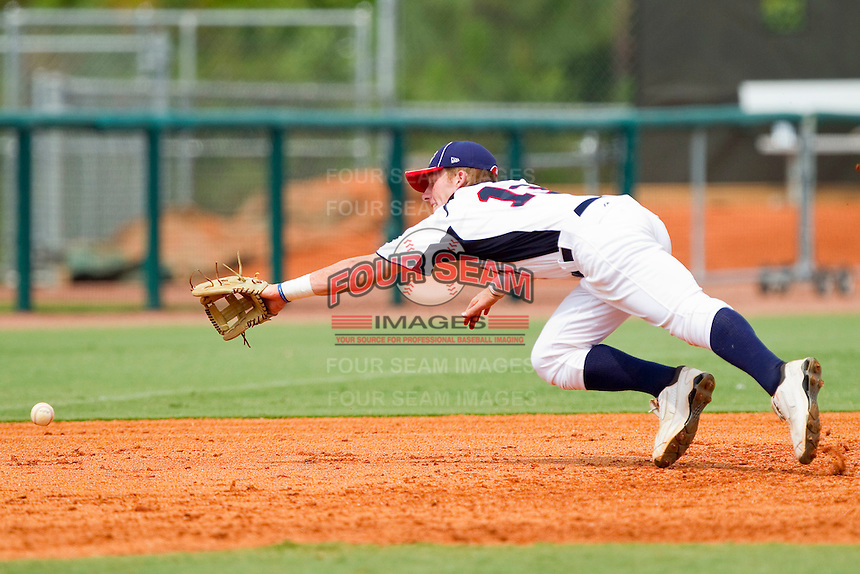 Third baseman Max Dutto #13 of STARS makes a diving attempt for a ground ball against RBI at the 2011 Tournament of Stars at the USA Baseball National Training Center on June 26, 2011 in Cary, North Carolina. (Brian Westerholt/Four Seam Images)