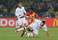 Clint Dempsey of the USA takes on Samuel Inkoom of Ghana. USA vs Ghana in the 2010 FIFA World Cup at Royal Bafokeng Stadium in Rustenburg, South Africa on June 26, 2010.