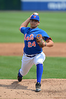 Pitcher Austin Riley (24) of DeSoto Central High School in Hernando, Mississippi playing for the New York Mets scout team during the East Coast Pro Showcase on July 31, 2013 at NBT Bank Stadium in Syracuse, New York.  (Mike Janes/Four Seam Images)