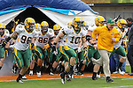 North Dakota State Bison head coach, Craig Bohl, leads his team out onto the field before the FCS Championship game between the North Dakota State Bison and the Sam Houston State Bearkats at the FC Dallas Stadium in Frisco, Texas. North Dakota defeats Sam Houston 39 to 13..