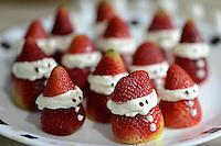 BOGOTA- COLOMBIA-08-12-2013. Postre de Fresas y crema chantilli con forma de Papá Noel. Strawberries and whipped cream dessert  in the shape of Santa Claus. Photo: VizzorImage