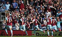 29th August 2021; Turf Moor, Burnley, Lancashire, England; Premier League football, Burnley versus Leeds United: Chris Wood of Burnley celebrates his 61st minute goal with his team mates in front of the home fans