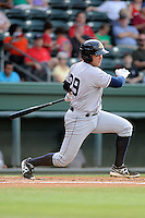 Infielder Dante Bichette, Jr. (19) of the Charleston RiverDogs bats in a game against the Greenville Drive on Wednesday, June 12, 2013, at Fluor Field at the West End in Greenville, South Carolina. Bichette Jr. is the No. 21 prospect for the New York Yankees, according to Baseball America. Charleston won, 9-7. (Tom Priddy/Four Seam Images)