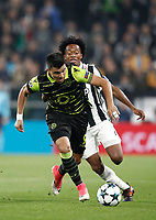 Football Soccer: UEFA Champions League Juventus vs Sporting Clube de Portugal, Allianz Stadium. Turin, Italy, October 18, 2017. <br /> Sporting Clube de Portugal's Marcos Acuna (l) in action with Juventus' Juan Cuadrado (r) during the Uefa Champions League football soccer match between Juventus and Sporting Clube de Portugal at Allianz Stadium in Turin, October 18, 2017.<br /> UPDATE IMAGES PRESS/Isabella Bonotto