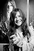 Janis Joplin at home with Bob Seidemann poster, Haight-Ashbury, San Francisco, November 1967<br /> Photo Credit: Baron Wolman\AtlasIcons.com<br /> Photo Credit: Baron Wolman\AtlasIcons.com