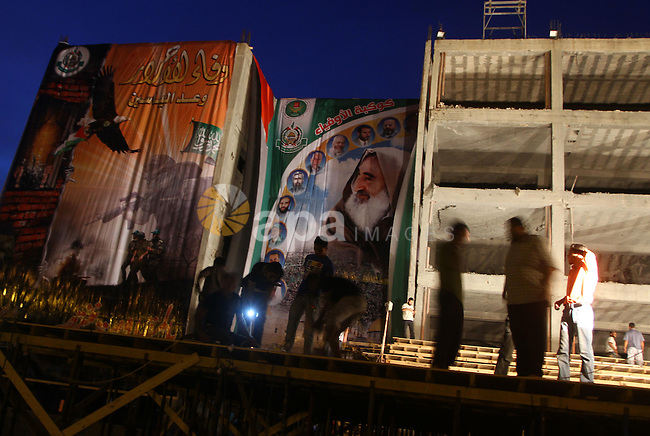 Palestinian men work on the stage that will be used to welcome prisoners released in the swap with Israel in Gaza City, Monday, Oct. 17, 2011. The elaborate machinery of a prisoner swap deal between two bitter enemies swung into motion Monday, as hundreds of Palestinian prisoners and one Israeli soldier prepared to return home in one of the most dramatic recent developments in the otherwise deadlocked Israel-Palestinian conflict. Photo by Ashraf Amra