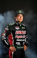 Mar. 22, 2014; Chandler, AZ, USA; LOORRS pro 2 driver Rodrigo Ampudia poses for a portrait prior to round one at Wild Horse Motorsports Park. Mandatory Credit: Mark J. Rebilas-USA TODAY Sports