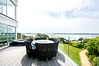 BNPS.co.uk (01202) 558833. <br /> Pic: TailorMade/AshleyFaull/BNPS<br /> <br /> Pictured: The garden terrace of the £6m mansion which has now been demolished. <br /> <br /> A wealthy homeowner has made the 'brave' decision to demolish his £6m seaside mansion that has its own indoor pool, gym and cinema. <br /> <br /> Ashley Faull has flattened the 20-year-old luxury house to build nine new flats to meet the increasing demand for housing that has led to a surge in property prices.<br /> <br /> The apartments will be priced between £1.495m to £2.8m.<br /> <br /> The now ruined four-storey and 19-room home sits on a half-an-acre plot that backs on to Poole Harbour and overlooks exclusive Sandbanks in Dorset.