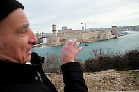 Gerard, a volunteer guide with the Marseille Provence Greeters, towards 17th century Fort Saint-Jean at the entrance to the Old Port of Marseille, Marseille, France, 04 February 2013
