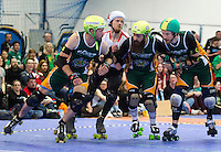 15 MAR 2014 - BIRMINGHAM, GBR - Team England jammer Reaper (second from the left) looks for a way through a Wizards of Aus wall during the inaugural Men's Roller Derby World Cup at the Futsal Arena in Birmingham, West Midlands, Great Britain (PHOTO COPYRIGHT © 2014 NIGEL FARROW, ALL RIGHTS RESERVED)