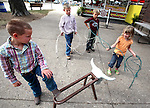 Catrina Dixson, 4, right, tries her hand at roping with a lasso while (from left) Jacob Derrer, 6, of Portales, New Mexico, his brother Bryce Derrer, 8, and Freeman Detweiler, 8, of Stoughton, Wisc., watch her performance Friday at the Iowa State Fair.