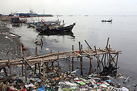 A fish boat comes into the port area of northern Jakarta. The bay has become heavily polluted as a result of run-off from the nearby city.