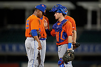 St. Lucie Mets catcher Matt O'Neill (5) talks with pitcher Luis Moreno (29) during a game against the Fort Myers Mighty Mussels on June 3, 2021 at Hammond Stadium in Fort Myers, Florida.  (Mike Janes/Four Seam Images)