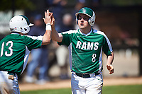 Farmingdale State Rams Justin Norcini (8) high fives Nick Attardi (13) after scoring a run during the first game of a doubleheader against the FDU-Florham Devils on March 15, 2017 at Lake Myrtle Park in Auburndale, Florida.  Farmingdale defeated FDU-Florham 6-3.  (Mike Janes/Four Seam Images)