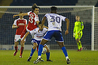 Fleetwood Town's Markus Schwabl (left)  battles with Bury's Tsun Dai (c) during the The Checkatrade Trophy match between Bury and Fleetwood Town at Gigg Lane, Bury, England on 9 January 2018. Photo by Juel Miah/PRiME Media Images.