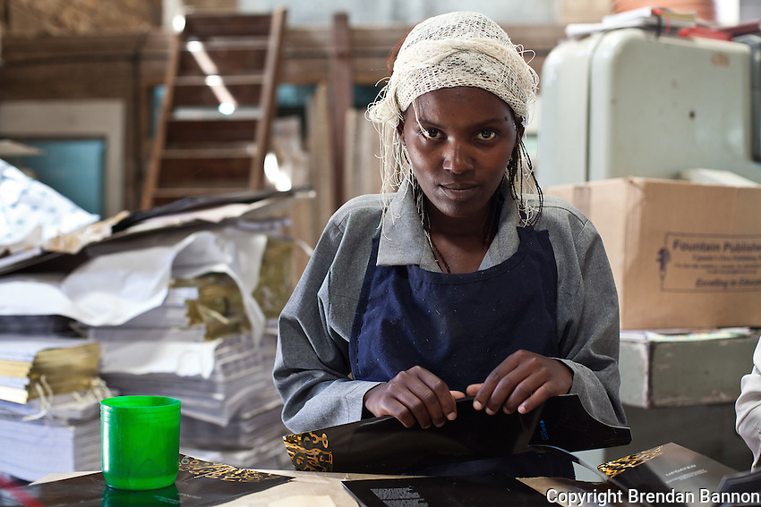 Zipporah Mutuku, a casual worker, assembles bank brochures printed at Colourprint in Nairobi, Kenya.