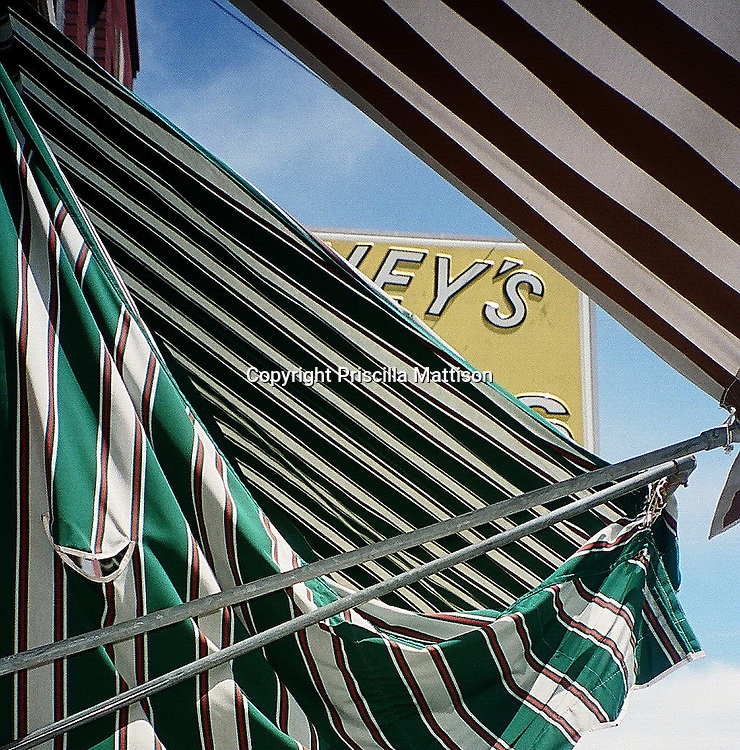 Striped awnings hang in a Michigan town.