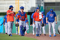 St. Lucie Mets pitcher J.T. Ginn (47) walks to the dugout with catcher Matt O'Neill (5) and hitting coach Tommy Joseph (left) before a game against the Fort Myers Mighty Mussels on June 3, 2021 at Hammond Stadium in Fort Myers, Florida.  (Mike Janes/Four Seam Images)