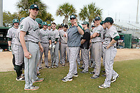 Slippery Rock head coach Jeff Messer (center) goes over the ground rules with his team before a game against the University of the Sciences Devils on March 6, 2015 at Jack Russell Field in Clearwater, Florida.  Slippery Rock defeated University of the Sciences 6-3.  (Mike Janes/Four Seam Images)