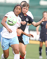 Rebecca Moros #19 of the Washington Freedom comes up behind Chioma Igwe #12 of the Chicago Red Stars during a WPS match at RFK stadium on June 13 2009 in Washington D.C. The game ended in a 0-0 tie.