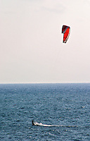 A surfer wind gliding with a sail wing. Sitges, Catalonia, Spain