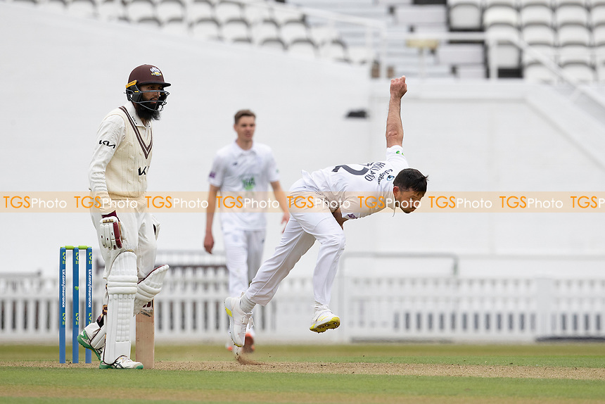 Ian Holland, Hampshire CCC follows through as Hashim Amla backs up during Surrey CCC vs Hampshire CCC, LV Insurance County Championship Group 2 Cricket at the Kia Oval on 30th April 2021